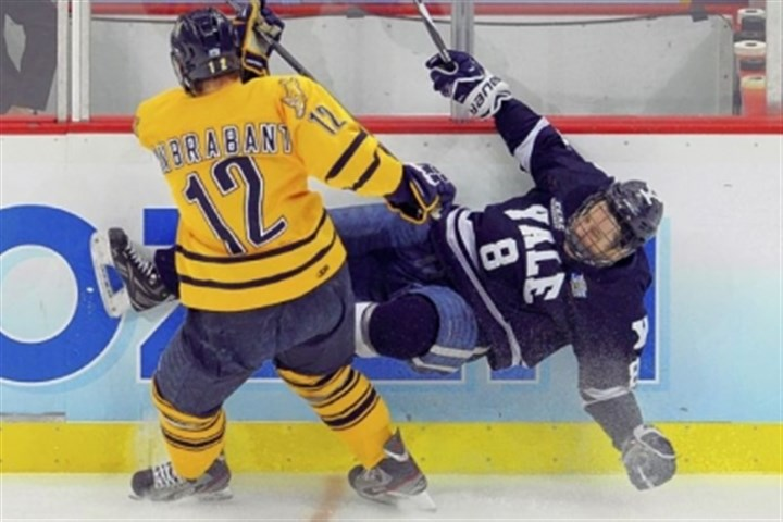 vanbrabant Quinnipiac's Bryce Van Brabant checks Yale's Josh Balch into the boards in the first period of the championship game Saturday night at Consol Energy Center.