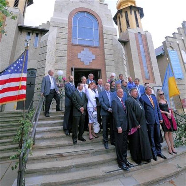 Visiting from afar A delegation from Ukraine is visiting the region to study shale gas, stopping at St. Peter and Paul Ukrainian Orthodox Church in Carnegie, where they met with Rep. Tim Murphy, left front.
