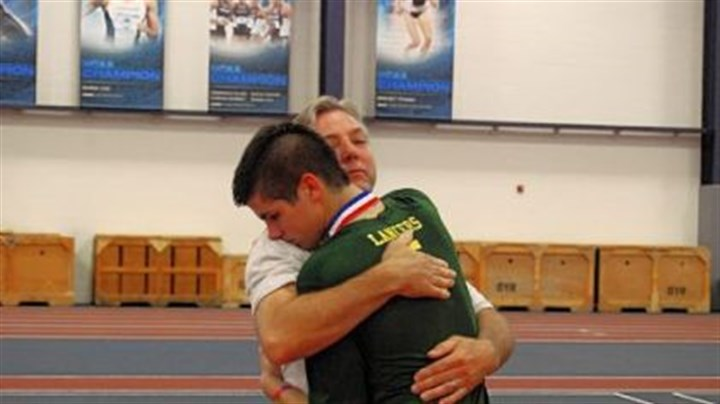 volleyball Deer Lakes assistant coach Terry Gaston hugs his son, Jeremy, a current player for the Lancers after Deer Lakes won the PIAA Class AA title Saturday at Penn State University.
