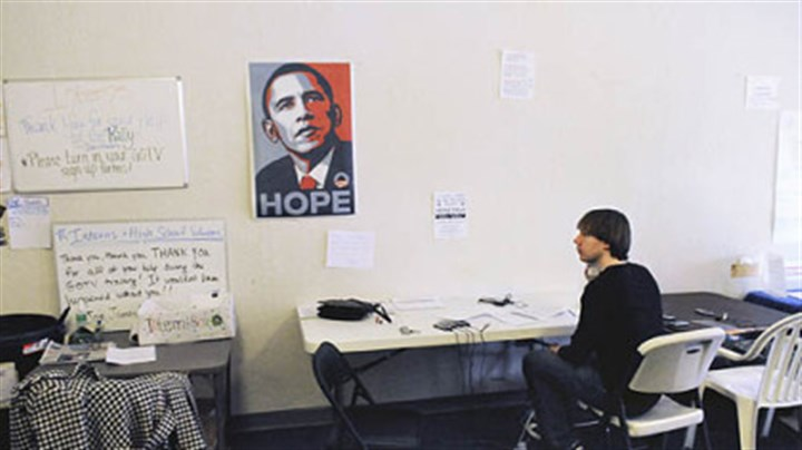 Volunteers David Sangalli, of New York City, works the phones in the Mt. Lebanon office of the Obama Campaign.