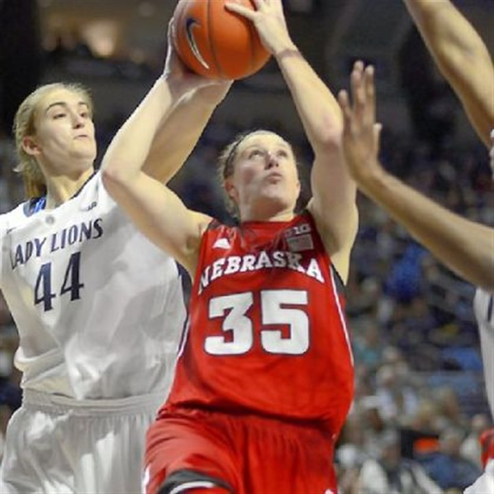 Waldner Nebraska's Jordan Hooper shoots as Penn State's Tori Waldner defends from behind Sunday in the Nittany Lions' 80-58 win.