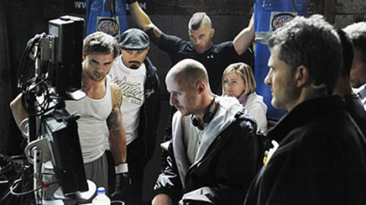 """Warrior"" 3 Cast and crew gather around director Gavin O'Connor to watch a take during the filming of ""Warrior"" in the Gage Building in the Strip District on Tuesday."
