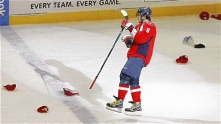 Washington Capitals' Alex Ovechkin The Washington Capitals' Alex Ovechkin skates past hats after scoring his third goal in the third period Sunday against the Penguins.