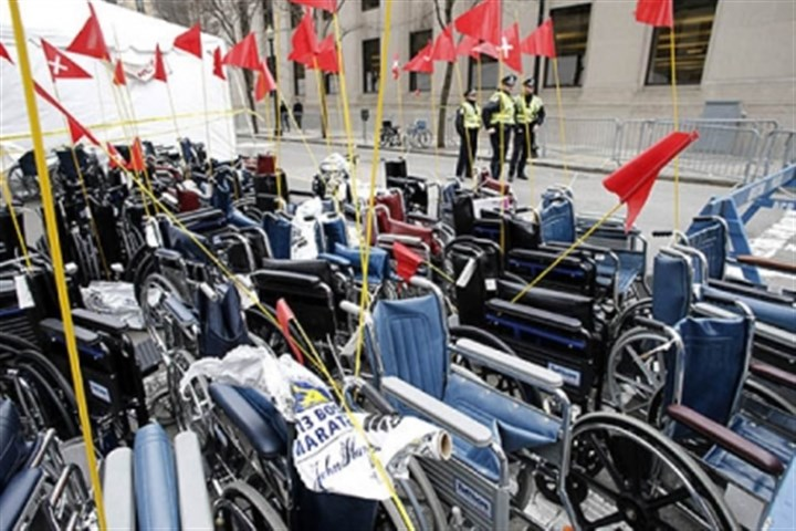 watch over wheelchairs Boston police stand watch over wheelchairs used in Monday's Boston Marathon. The bombs that ripped through the Boston Marathon crowd were fashioned out of ordinary kitchen pressure cookers, packed with nails and other fiendishly lethal shrapnel, and hidden in duffel bags left on the ground, people close to the investigation said Tuesday.