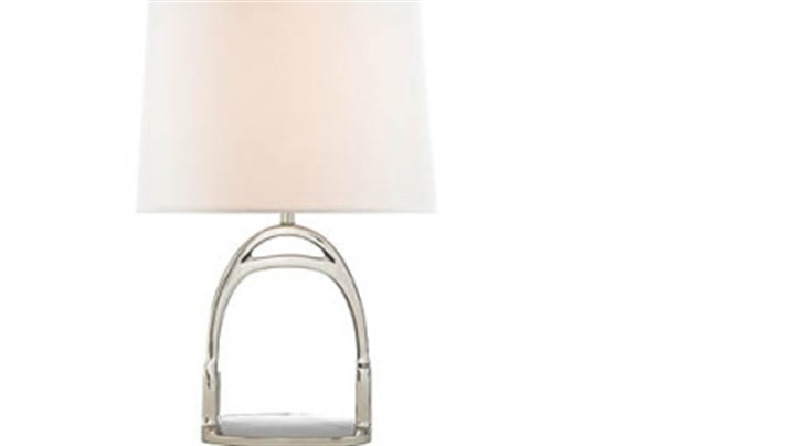 Wesbury accent lamp by Ralph Lauren The Westbury accent lamp by Ralph Lauren features a stirrup design. It comes in nickel or brass and is available in two sizes. The one shown here retails for $1,200 www.ralphlaurenhome.com