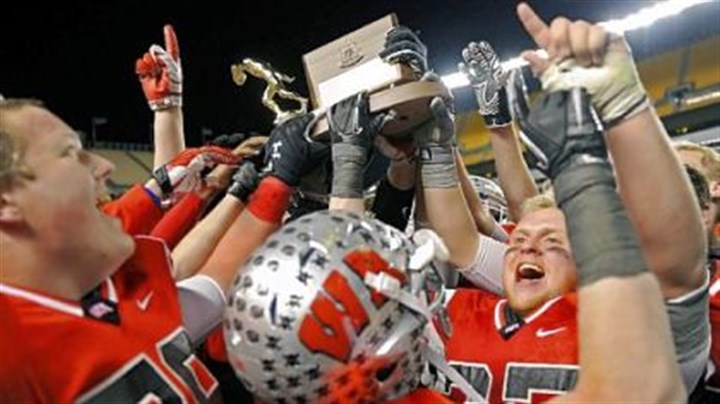 West Allegheny Trophy Joyous West Allegheny players hoist the WPIAL championship trophy after the Indians defeated West Mifflin, 34-8, last Friday at Heinz Field.