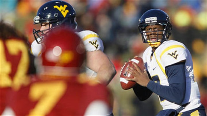 West Virginia quarterback Geno Smith West Virginia quarterback Geno Smith, right, drops back to pass during the first half of an NCAA college football game against Iowa State, Friday, in Ames, Iowa.