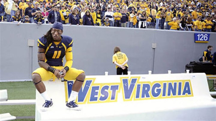 West Virginia's Bruce Irvin West Virginia's Bruce Irvin sits alone on the bench following a 19-14 loss against Syracuse Saturday in Morgantown, W.Va.