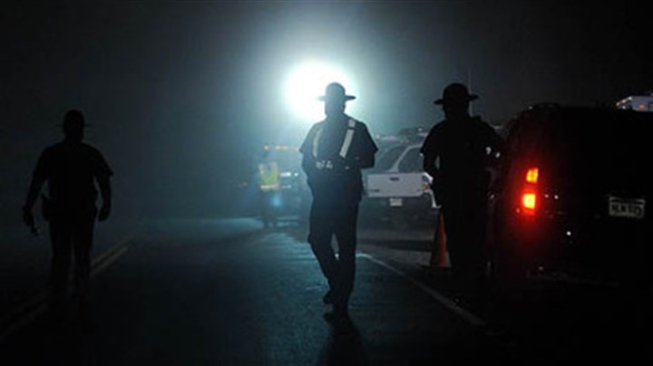 West Virginia State Police West Virginia State Police officers direct traffic in front of an entrance to Massey Energy's Upper Big Branch mine in Raleigh County after an explosion there killed at least 25 people, Monday.