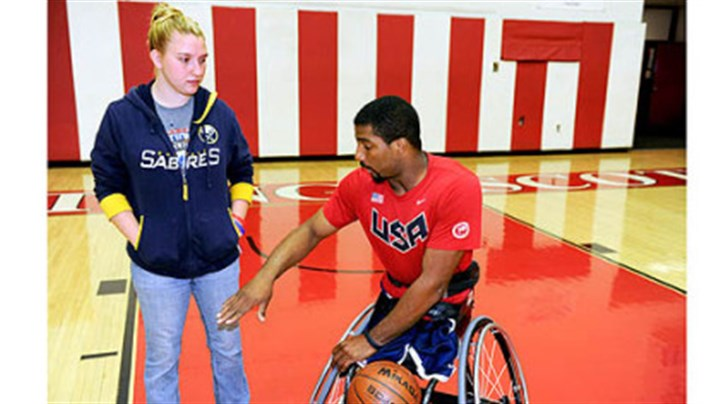 wheelchair basketball player Trevon Jenifer Trevon Jenifer explains game strategy to his girlfriend of nearly four years, Laura Klass.