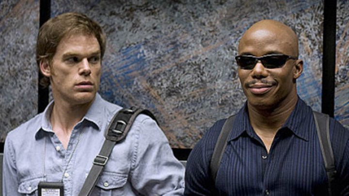 "Who's smiling now? Michael C. Hall as Dexter and Erik King as Sgt. Doakes before everything exploded on ""Dexter."""