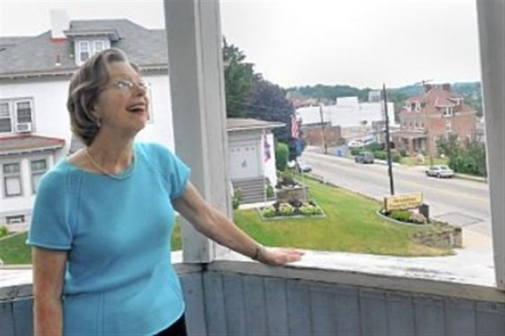 Wigman house Kitty Martin, the granddaughter of William Wigman, who built the Queen Anne house at 1425 Brownsville Road in Carrick, examines the workmanship of the second floor balcony off a bedroom.