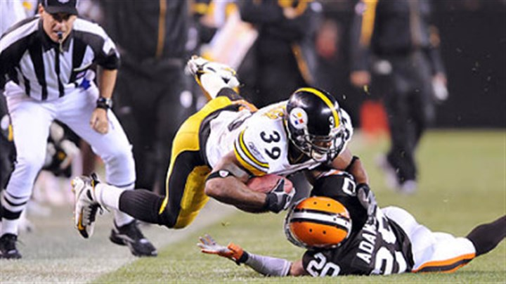 Willie Parker Steelers running back Willie Parker is tackled by the Browns' Mike Adams last night.