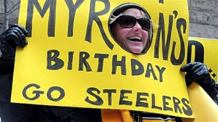 Win it for Myron Julia Sarver, of North Versailles, shows her support for the Steelers to win on Myron Cope's birthday during a rally at the county courthouse.
