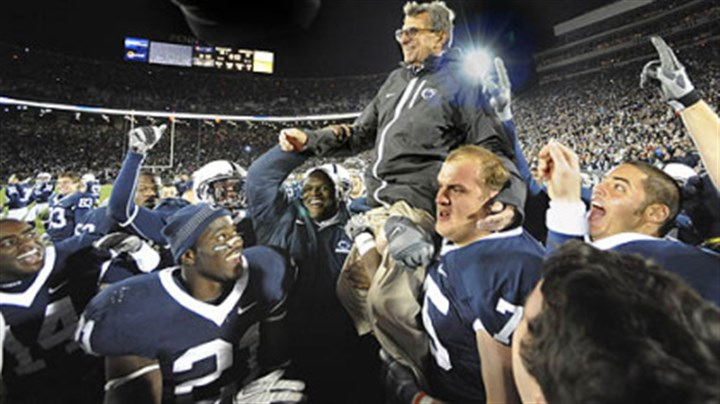 Win No. 400 Joe Paterno gets carried off the field after getting his 400th win against Northwestern at Beaver Stadium on November 6, 2010.