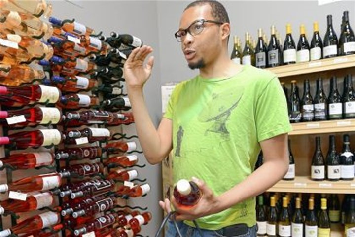 Wine Matthew McAliley of Pittsburgh's Bloomfield neighborhood likes the idea of expanded hours of the Wine & Spirits store in East Liberty.