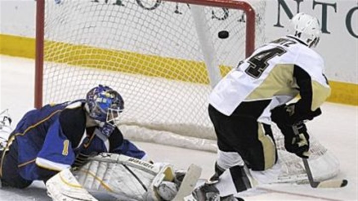 Winning goal Chris Kunitz, right, flips the winning shootout goal past Blues goalie Brian Elliott Tuesday night in St. Louis. The 3-2 victory extended the Penguins' winning streak to seven games going into the All-Star break.