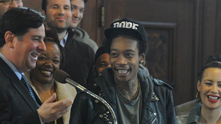 wiz khalifa and bill peduto smiling Pittsburgh City Councilman Bill Peduto laughs with Wiz Khalifa and his family, after reading the proclamation that Dec. 12, 2012, will be Wiz Khalifa Day.