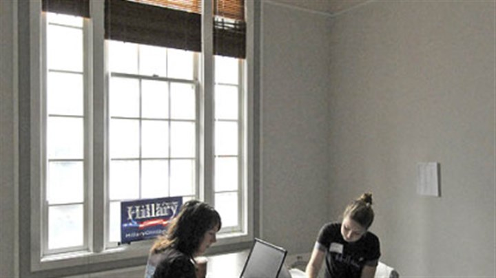 "Women for Clinton Sarah Bell, left, and Elizabeth Baribeau, campaign volunteers from San Francisco, work at Hillary for President headquarters on Smithfield Street yesterday as part of the ""All Voices Count"" women's tour, which is spending two days going from Pittsburgh to Carlisle."