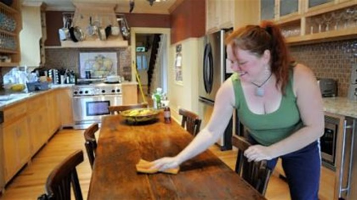 wooden table Here she uses a natural almond oil solution to clean a wooden table.