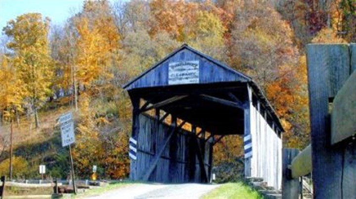 Woods Covered Bridge Afternoon sunlight bathes the Woods Covered Bridge in Center, Greene County, in 2001.