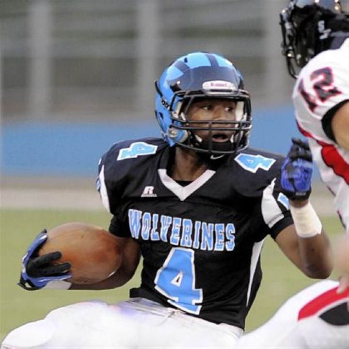 Woody High Woodland Hills running back Miles Sanders looks for running room against a stingy Upper St. Clair defense.