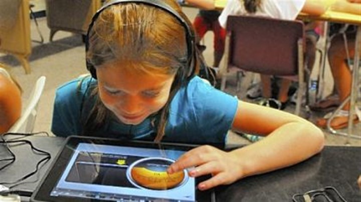 "Work at school Ella Sticha, 9, works on the ""Garage Band"" program in music class at McMurray Elementary School."