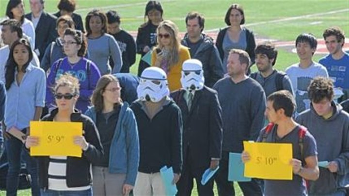 World Statistics Day Theodore Dasher, 21, left, and Shazwan Azizan, 22, both Carnegie Mellon University students, wear Star Wars storm trooper masks while participating in a campus celebration of the first World Statistics Day Wednesday. About 150 CMU faculty and staff formed a human histogram based on their height.