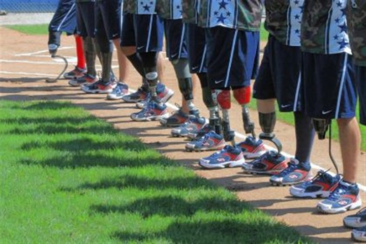 Wounded Warrior Members of the Wounded Warrior Amputee Softball Team line up prior to a game Saturday against the State Correctional Institution Pittsburgh/Greene team at Lew Hays Pony Field in Washington, Pa.