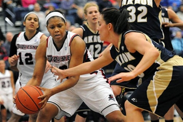 Wumi Agunbiade Duquesne's Wumi Agunbiade, left, keeps the rebound away from Akron's Taylor Ruper, right, in second half action.