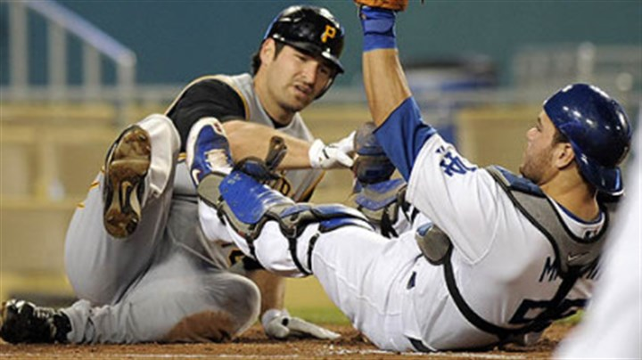 Xavier Nady Dodgers catcher Russell Martin holds up his glove after tagging out the Pirates' Xavier Nady at home plate during second the inning of their baseball game last night.