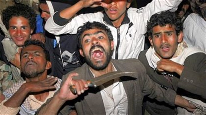 Yemen Yemeni anti-government protesters react Wednesday to the announcement that President Ali Abdullah Saleh would reliquish his office after 33 years in power.
