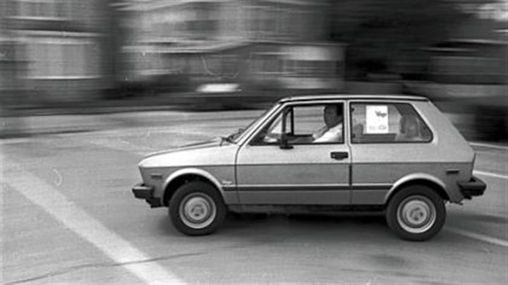 Yugo An unidentified man test drives a Yugo on the streets of Brockton, Mass. in this Aug. 27, 1985 photo.