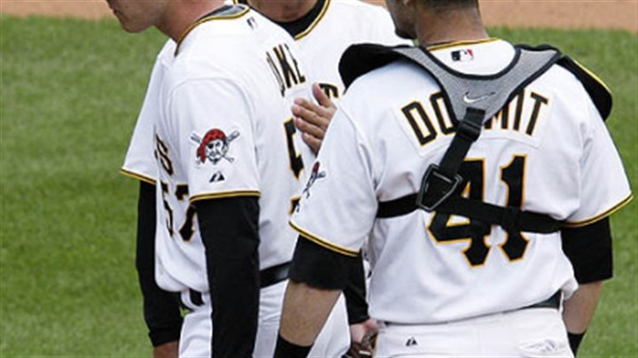 Zach Duke, John Russell and Ryan Doumit Pirates pitcher Zach Duke, left, is pulled from the game in the ninth inning with two outs, and with a 10-run lead by manager John Russell, center, as catcher Ryan Doumit watches during yesterday's 11-1 win at PNC Park.