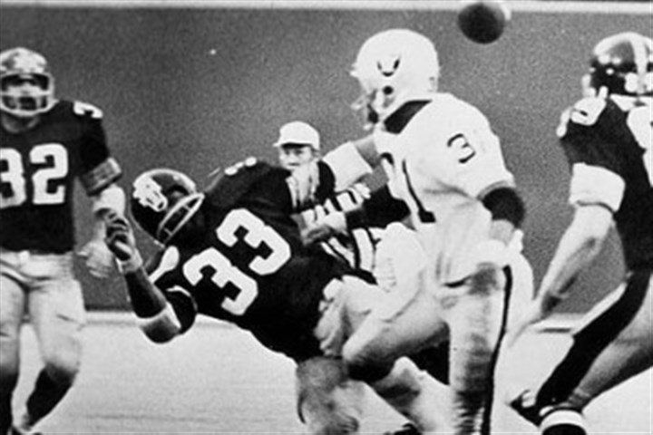 "franco1025 Franco Harris, far left, sees the ball fly into the air after the Oakland Raiders' Jack Tatum decks the Steelers' Frenchy Fuqua (33), setting up the ""Immaculate Reception."""