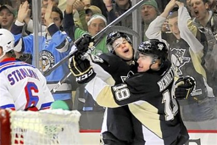 Bennett scores Beau Bennett, right, is congratulated by Tyler Kennedy after scoring in a game in March.