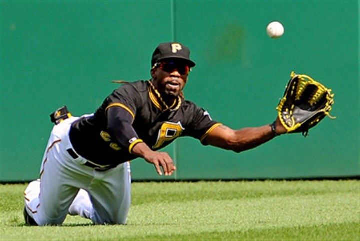 Daily0731k.jpg Andrew McCutchen dives to catch a ball hit by St. Louis' Carlos Beltran in the first inning of the first game of a double header at PNC Park in July.