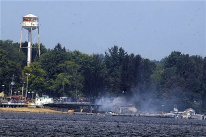 Conneaut Lake daytime A collapsed banquet hall and beach club at Conneaut Lake Park were destroyed in a 2008 fire.