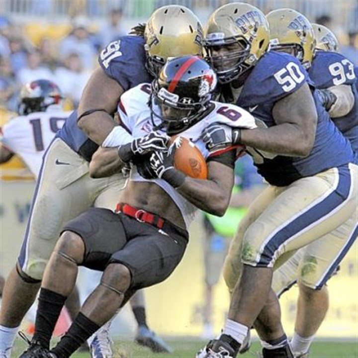 Pitts' Render Pitt''s Darryl Render (left) and Tyrone Ezell take down Gardner-Webb's Kenny Little during a game in 2012 at Heinz Field.