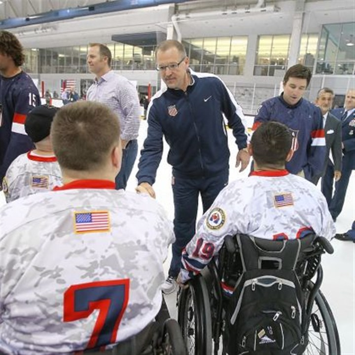 bylsma Dan Bylsma and United States hockey team candidates meet members of the Wounded Warrior Project at the team's camp in Arlington, Va.