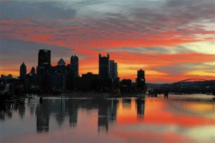 skyline for 30 The Pittsburgh skyline, reflected in the Ohio River just before sunrise.