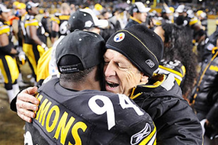lebeau0112 Former Steelers defensive coordinator Dick LeBeau shares a postgame hug with linebacker Lawrence Timmons.