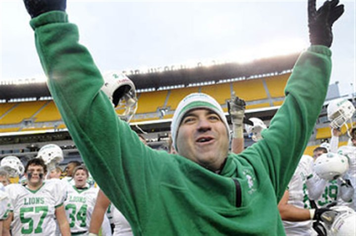 Joe Rossi South Fayette head coach Joe Rossi celebrates with his players after winning the WPIAL AA football Championships game against Aliquippa in 2010 at Heinz Field.