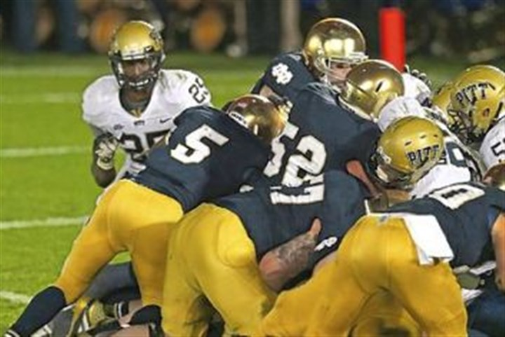 ND Golson Notre Dame quarterback Everett Golson (5) follows blockers into the end zone to score the winning touchdown in the third overtime against Pitt last year at Notre Dame Stadium.