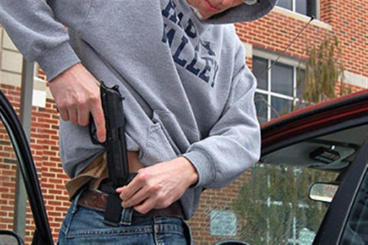Nathaniel Sheetz Applications for concealed carry permits jumped in 2013, Allegheny County Sheriff Bill Mullen said. In this photo, a Penn State student retrieves his permitted handgun from campus police in 2008.
