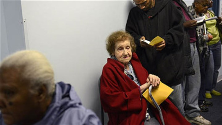 Sophie Sophie Masloff waits in line with others for voter identification at the CCAC Homewood-Brushton Center. She was 94 years old at the time.