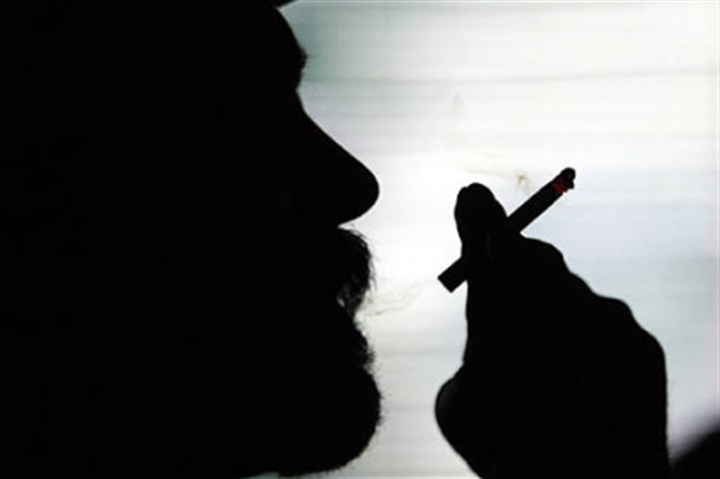 A man enjoys a cigarette Under a new policy, all UPMC personnel are banned from smoking during their shifts.