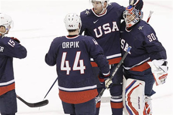 molinari0105 Penguins defenseman Brooks Orpik congratulates goalie Tim Thomas after the U.S. beat Finland, 6-1, in a semifinal at the 2010 Vancouver Olympics.