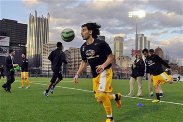 Pittsburgh Riverhounds captain Richard Costanzo Pittsburgh Riverhounds captain Richard Costanzo and teammates warm up before their inaugural game at the new Highmark Stadium last April against the Harrisburg City Islanders. A sellout crowd of almost 4,000 fans was in attendance.