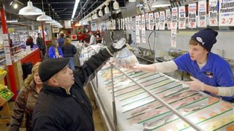 Where we go fish wholey 39 s draws hungry crowds a century for Wholey s fish market